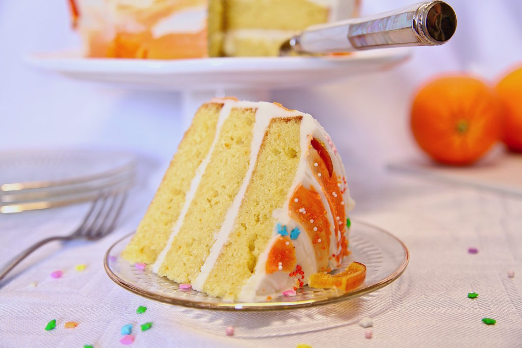 Moist Layer Orange Cake With Buttercream Frosting slice