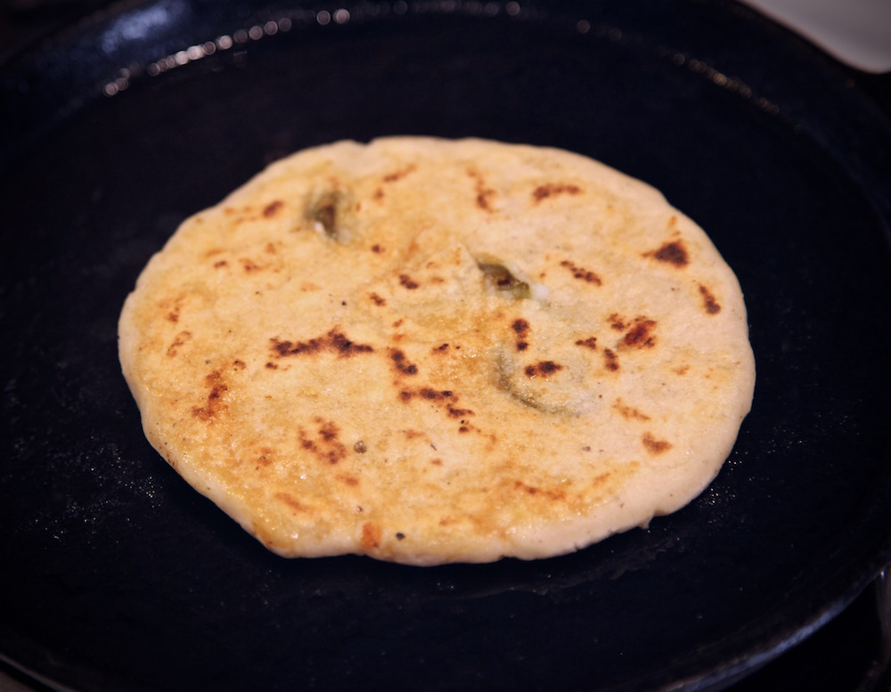 cooked pupusa on comal