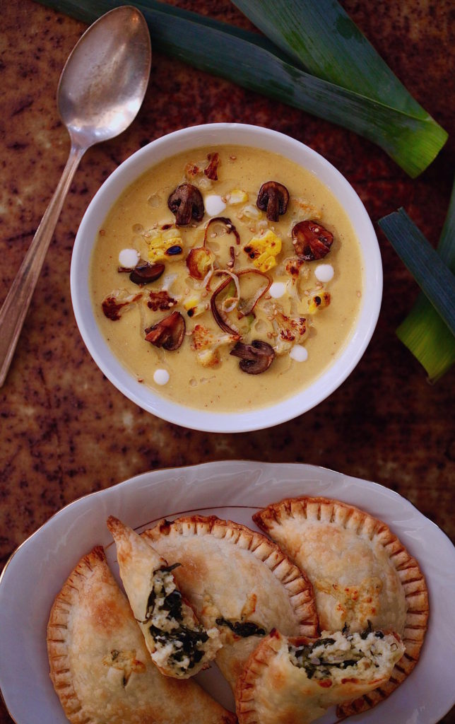 Cream of roasted cauliflower leek soup with empanadas