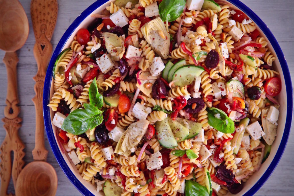 Mediterranean Rotini Pasta Salad is excellent as a side or an a partner to a green salad!