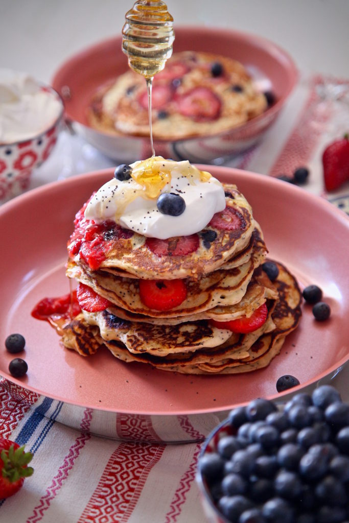 Berry Poppy Seed Pancakes with a honey drizzle