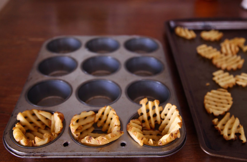 Grown In Idaho Waffle Fries line a cupcake pan to make baskets.